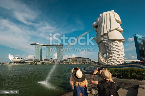 istock Tourists photographing Merlion Park and Marina Bay Sands at Marina Bay, Singapore 954735790