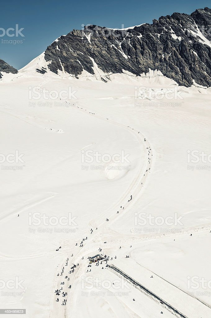 Tourists playing on the Aletsch Glacier, Switzerland - I royalty-free stock photo