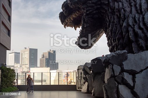 istock Tourists pose next to Godzilla on Hotel Gracery terrace in Tokyo, Japan 1151098816