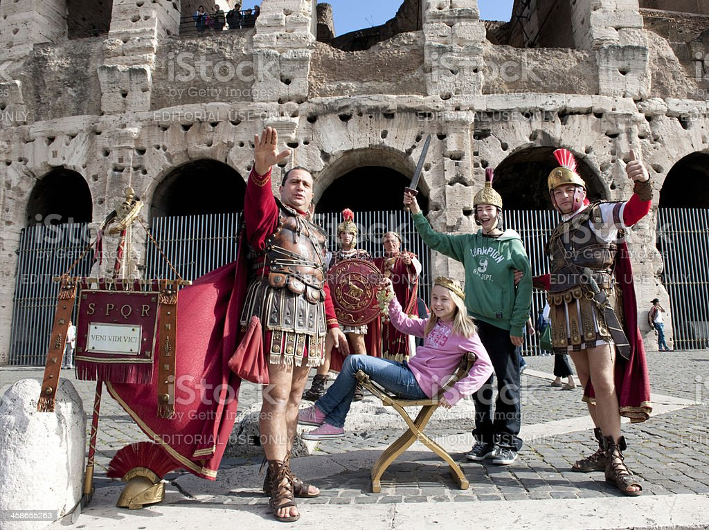 tourists posing in front of Coliseum Rome Italy XXXL image stock photo