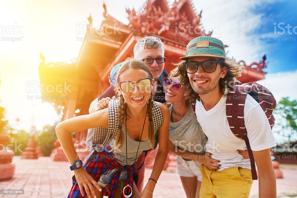 tourists posing in front of temple in koh samui thailand stock photo