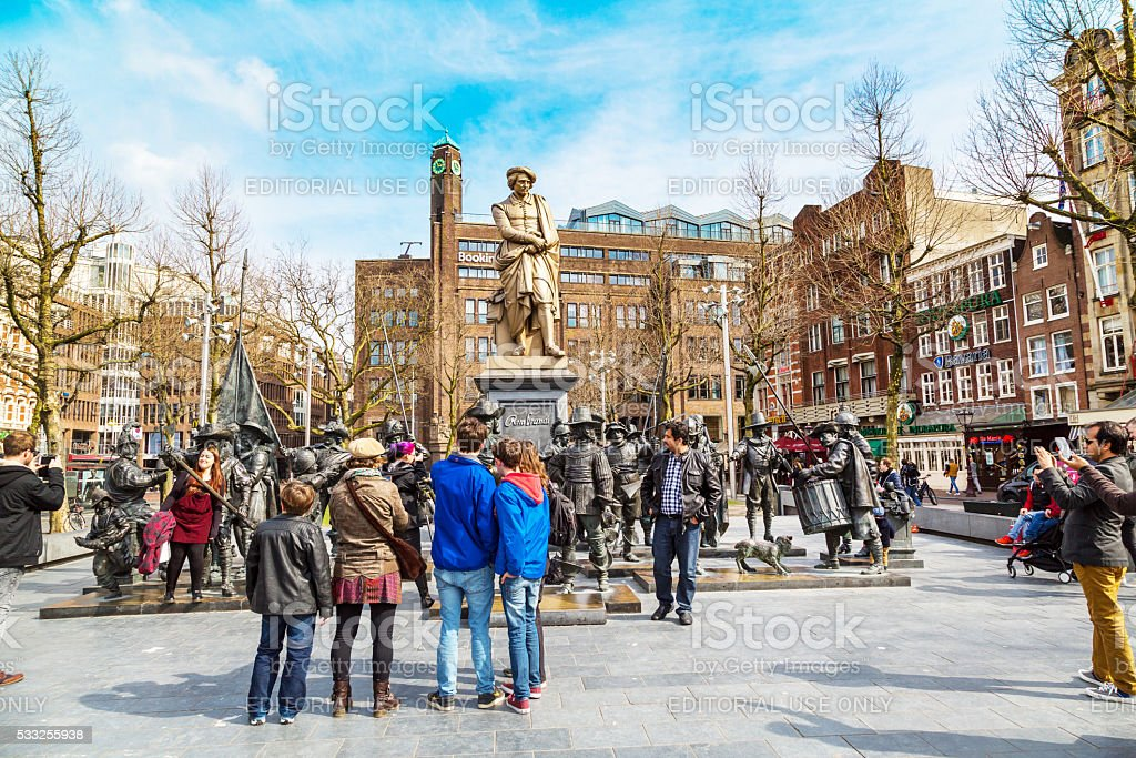 Tourists posing near Night Watch by Rembrandt in Rembrandtplein, Amsterdam stock photo
