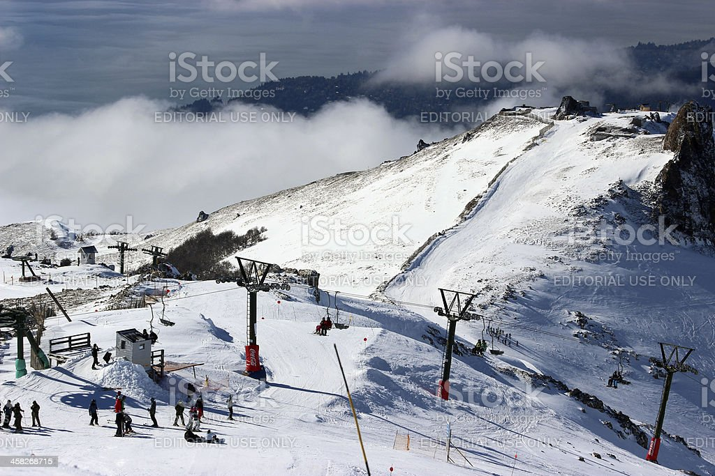 Tourists preparing to skiing above the clouds at Andes mountains royalty-free stock photo