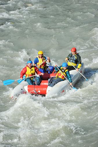 istock tourists rafting on the mountain river Mzymta on a catamaran 869481782