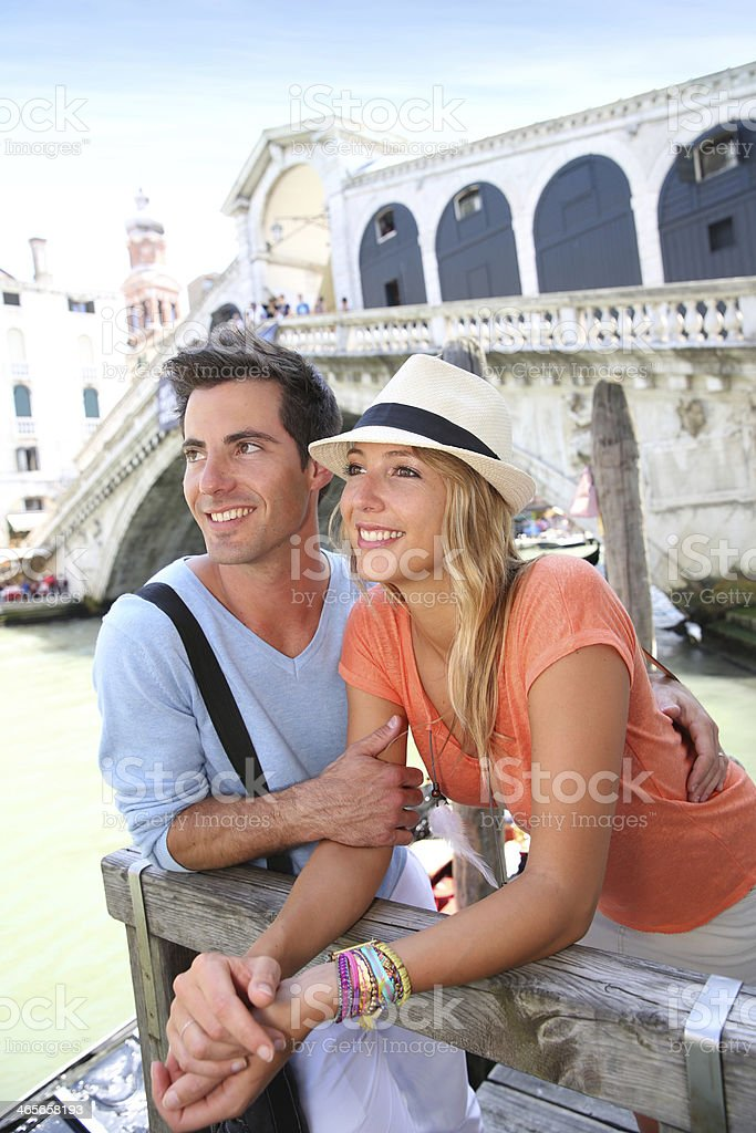 Tourists relaxing beside Rialto Bridge on sunny day royalty-free stock photo