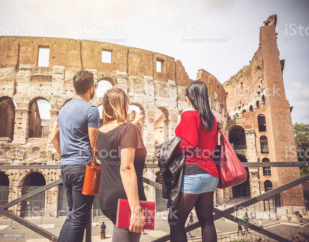 Tourists relaxing in front of the Coliseum, Rome stock photo