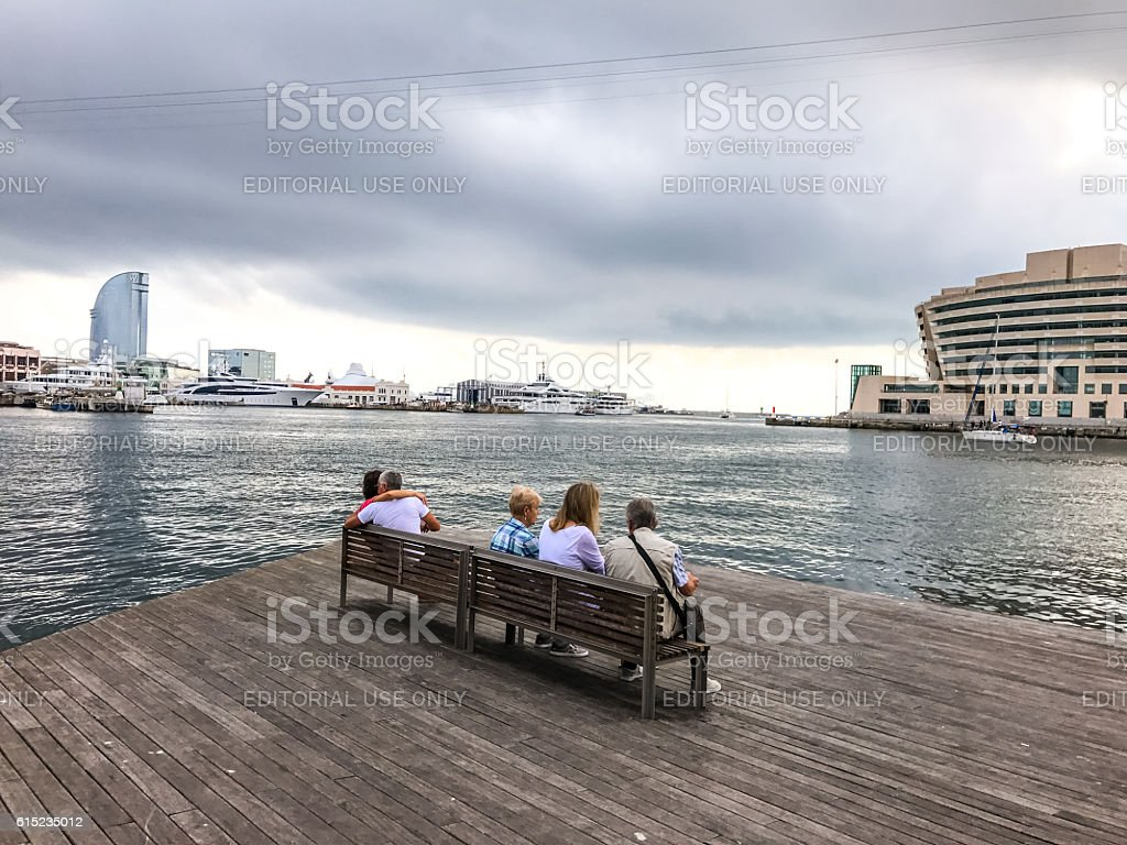 Tourists relaxing in Port Vell, Barcelona, Spain stock photo