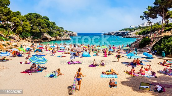 istock Tourists relaxing on Cala Esmeralda Beach, Santanyi, Mallorca 1180020287