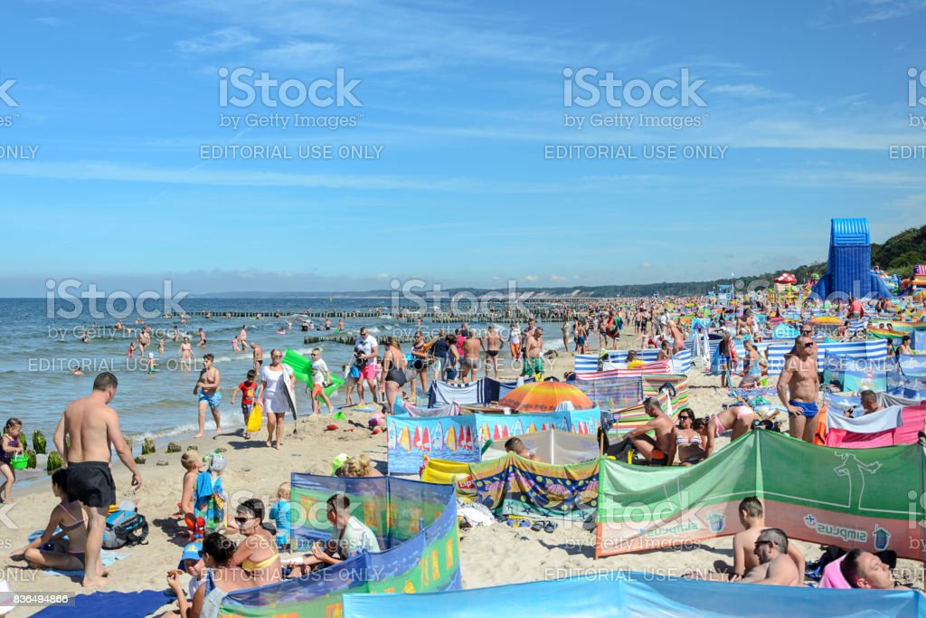 Tourists relaxing on the Baltic sea beach stock photo