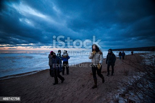 Wisconsin, USA - March 1, 2015: People return from visiting the ice caves at night in cold temps and high winds, Apostle Island National Lakeshore, Cornucopia, Bayfield County.