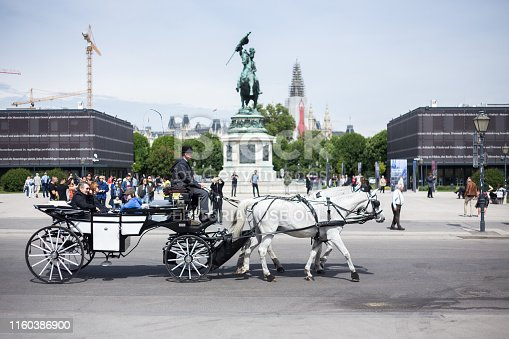 Vienna, Austria, May 11, 2019: Promenade carriage for tourists. Tourists ride in a carriage through the streets of the city. The driver shows a sights of Vienna to tourists.