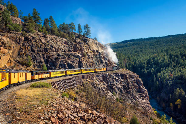 Tourists ride the historic steam engine train in Colorado, USA stock photo