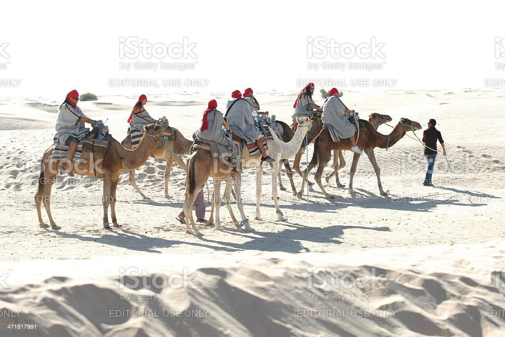 Tourists rideing camels, Sahara royalty-free stock photo