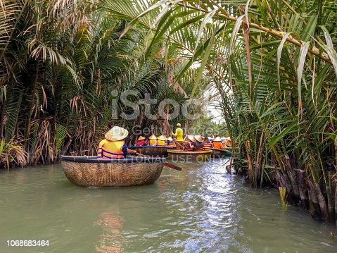 istock HOI AN ,VIETNAM- Nov 09, 2018:Tourists riding bamboo basket boats in Hoi An,vietnam 1068683464