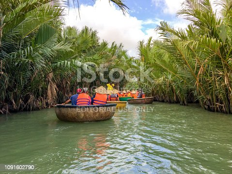 istock Tourists riding bamboo basket boats in Hoi An,vietnam 1091602790