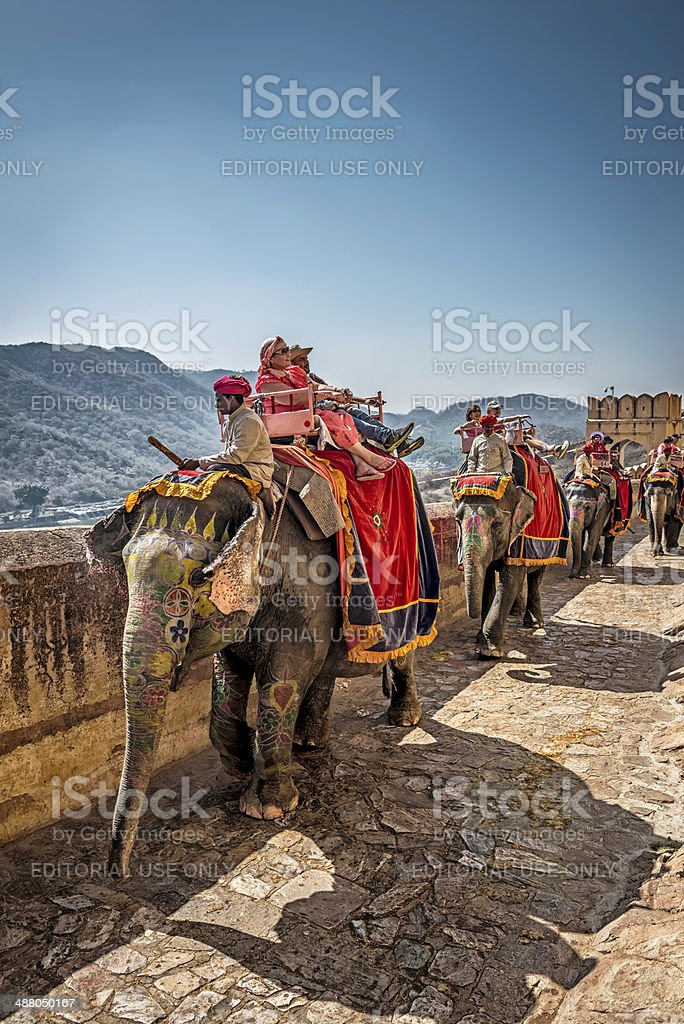 Tourists riding elephants coming toward Amber Fort, Jaipur stock photo