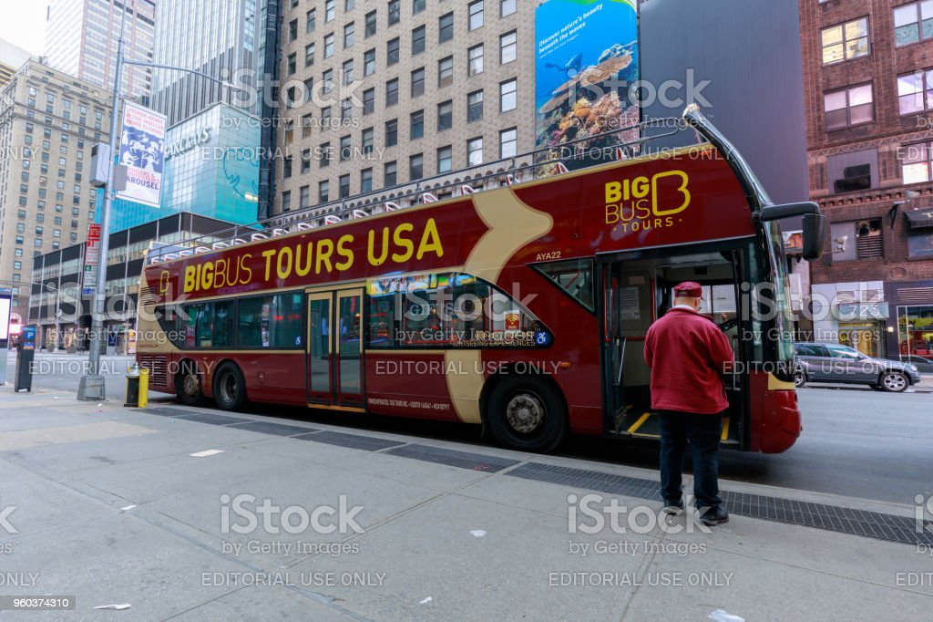 Tourists riding on Big Bus New York in Midtown Manhattan, NYC stock photo