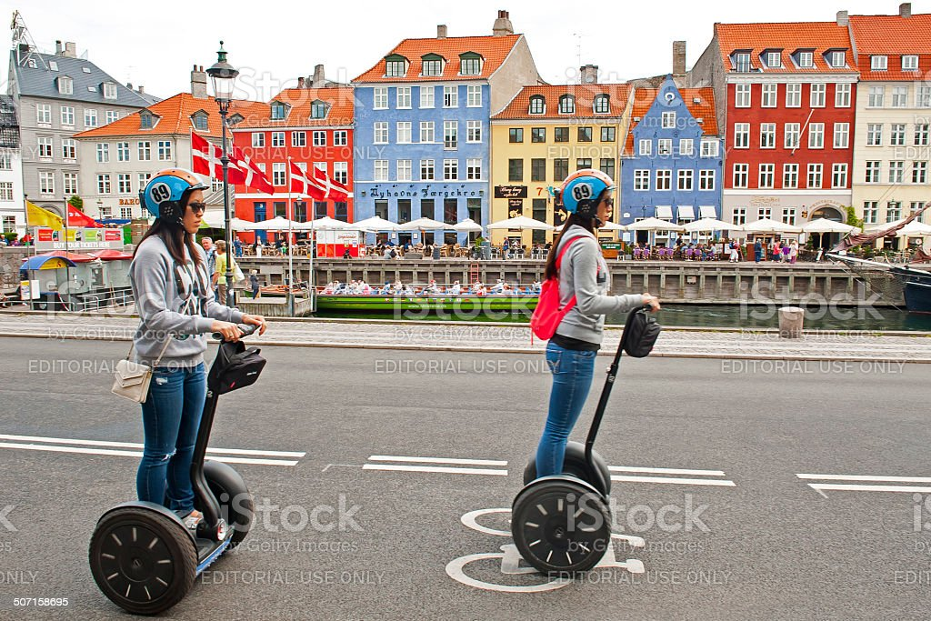 Tourists riding segways stock photo
