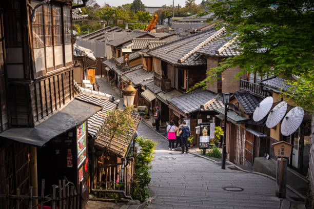 Tourists shopping along a charming street in the Higashiyama district in Kyoto, Japan stock photo