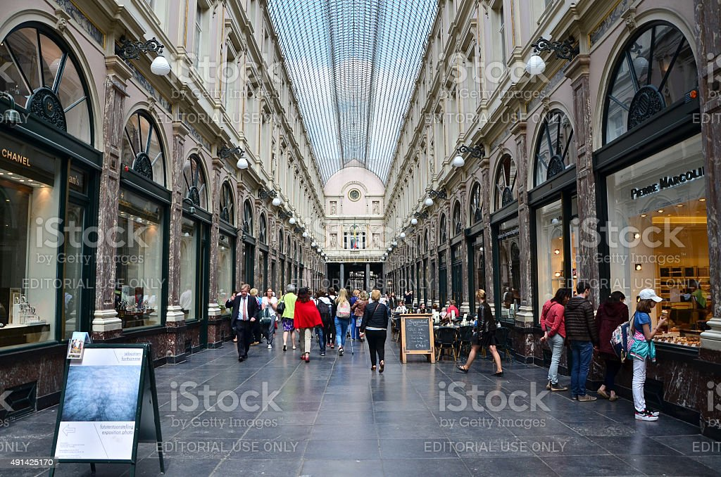 Tourists shopping at The Galeries Royales Saint-Hubert in Brussels stock photo