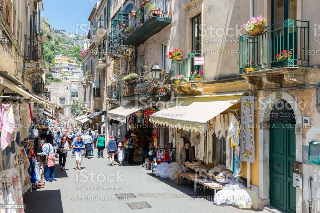 Tourists shopping in Taormina at the island Sicily stock photo