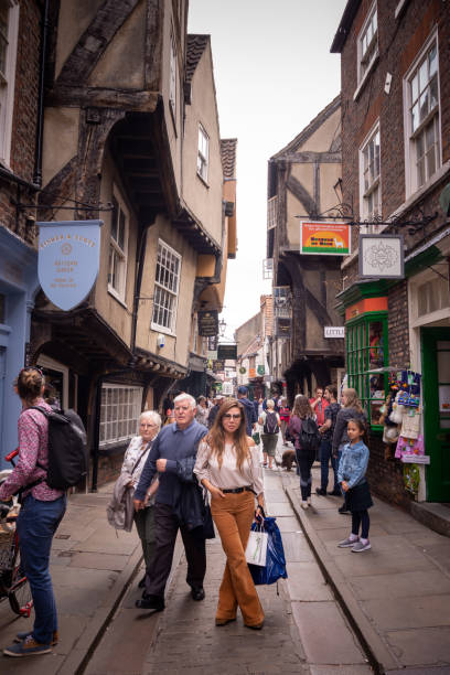 Tourists shopping on The Shambles in York, UK stock photo
