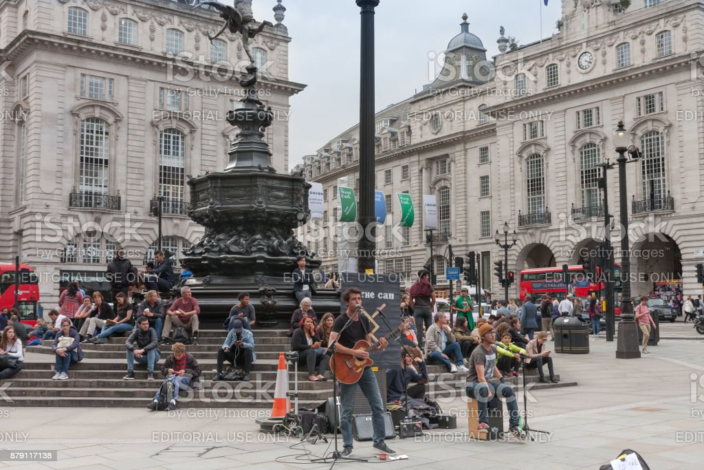 Tourists sitting and listening music band stock photo