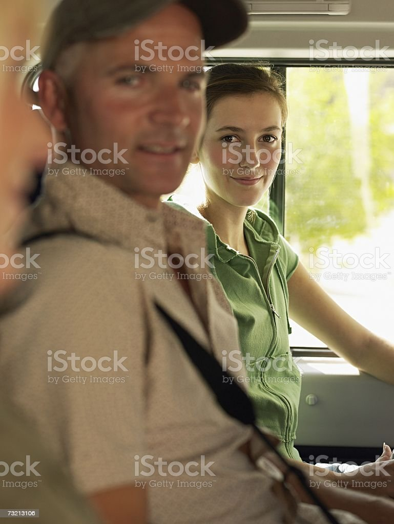 Tourists sitting in a people carrier royalty-free stock photo