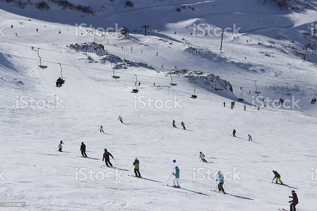 Tourists skiing in group at ski station CERRO CATEDRAL royalty-free stock photo