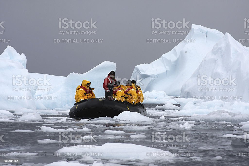 Tourists Studying the Icebergs in Cierva Cove Antarctica stock photo