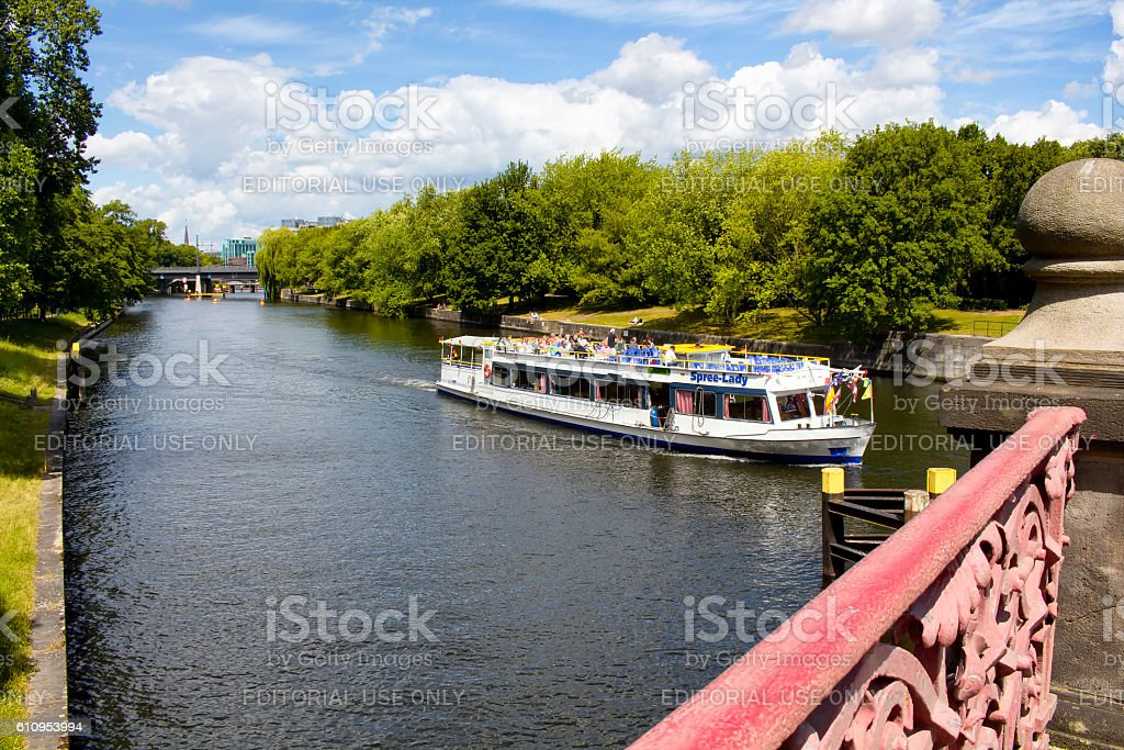 Tourists take boat tour on Spree river in Berlin. stock photo