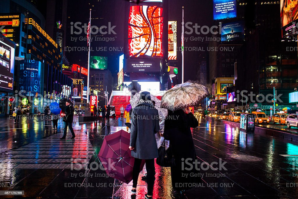Tourists Take in the scene in Times Square NYC stock photo