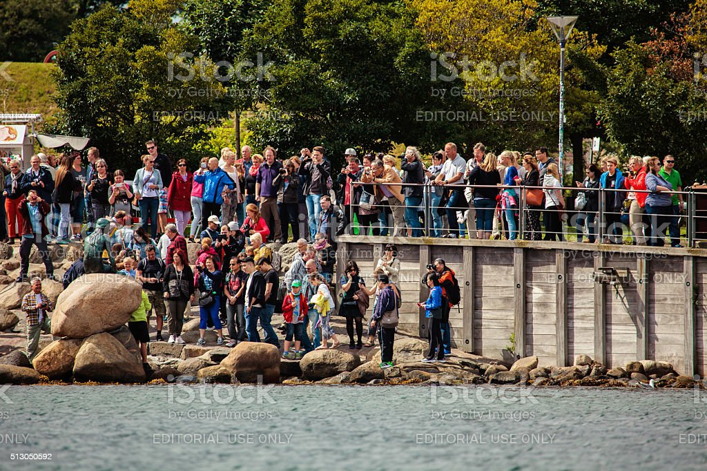 Tourists take pictures of the Little Mermaid stock photo