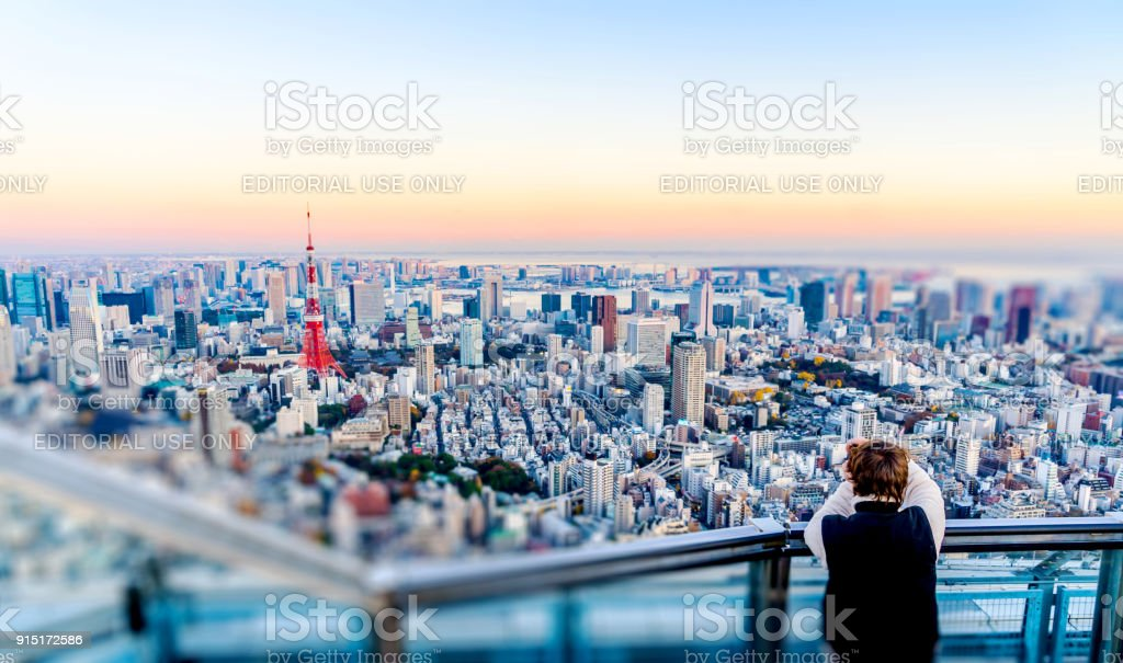 Tourists take shot of Tokyo Tower stock photo