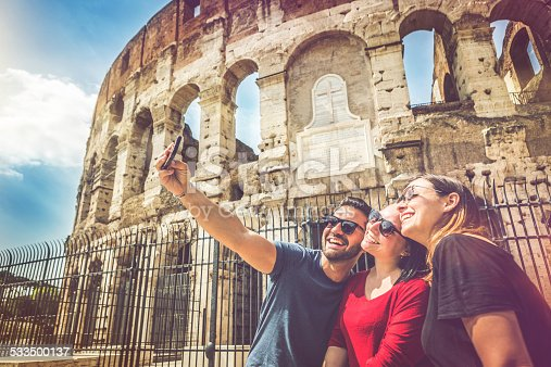 istock Tourists taking a selfie in front of the Coliseum, Rome 533500137