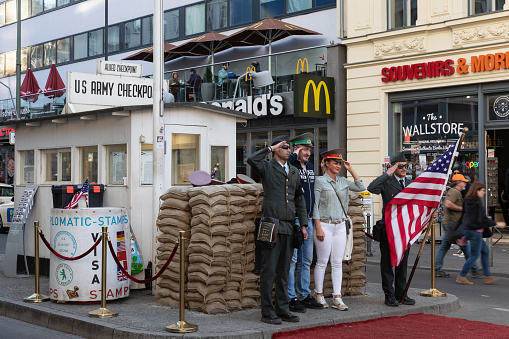 Tourists taking photo at the Checkpoint Charlie in Berlin