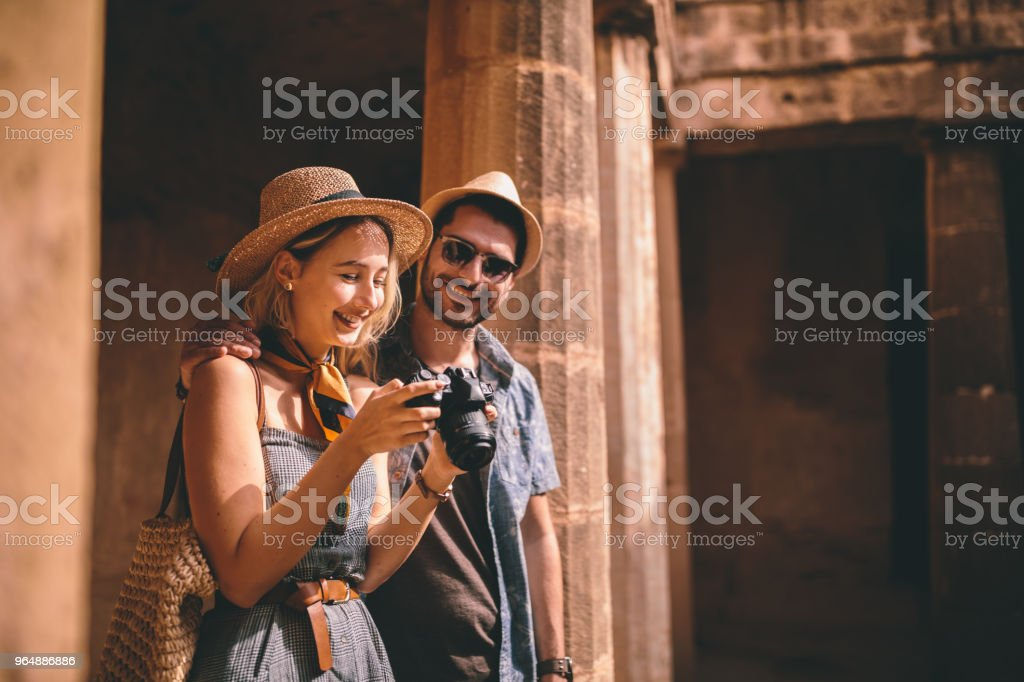 Tourists taking photos of ancient Italian monument with stone columns royalty-free stock photo