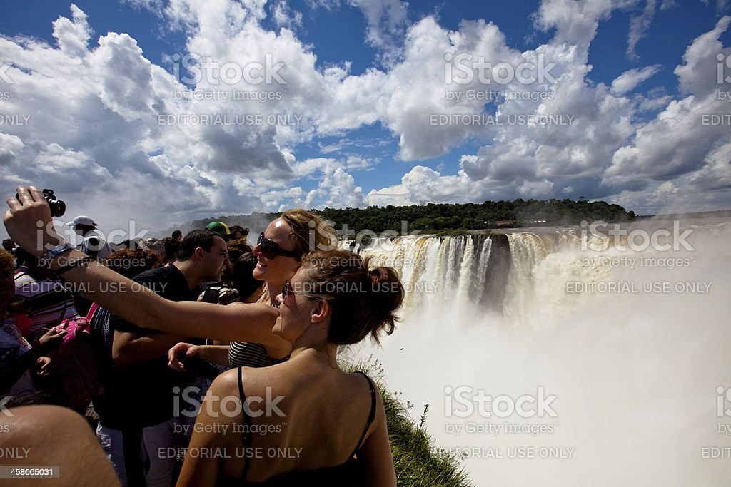 Tourists taking pictures of themselves with Iguazu in the background stock photo