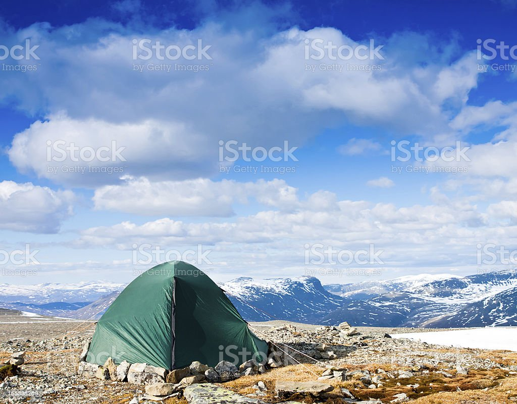 Tourists tent in the mountains on nice day royalty-free stock photo