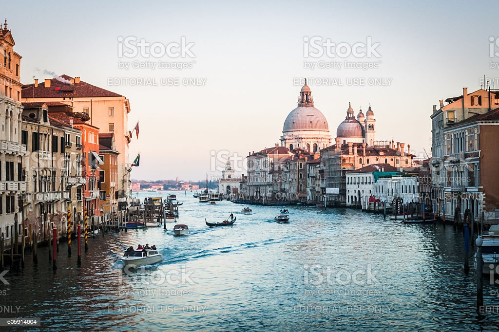 Tourists travel down the Grand Canal in boats and gondolas stock photo