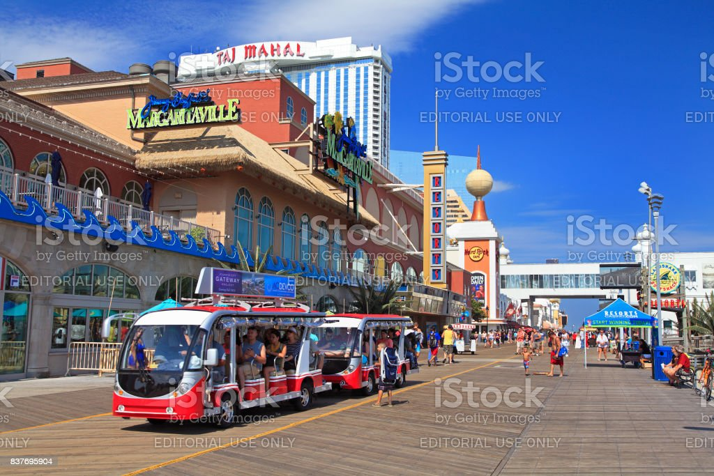 Tourists traveling on the boardwalk in Atlantic City, New Jersey stock photo