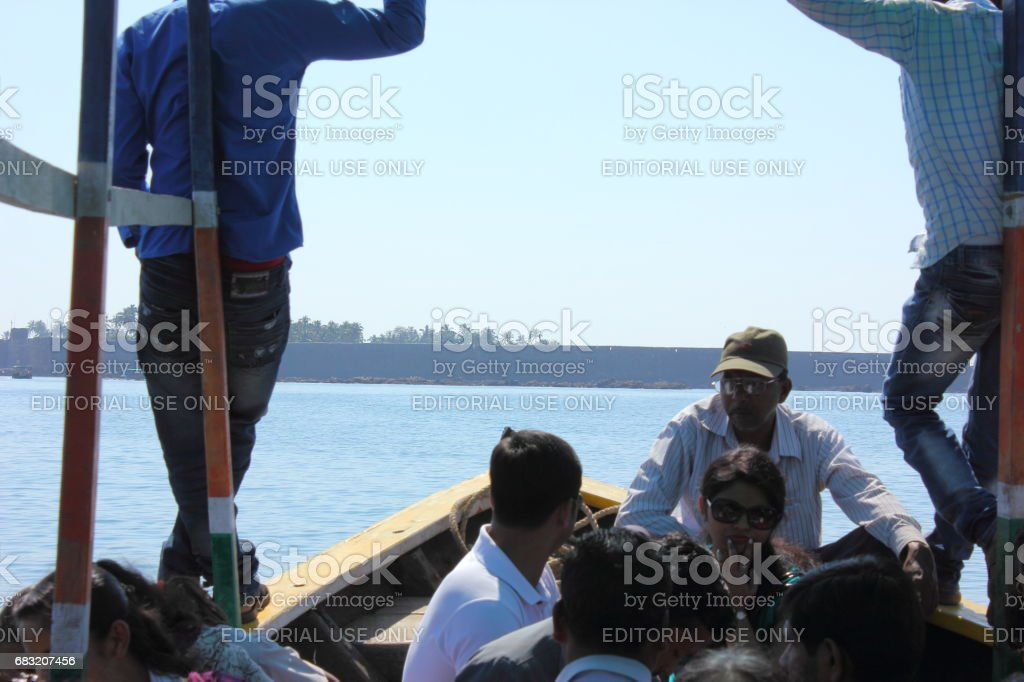 Tourists travelling in a boat foto de stock royalty-free