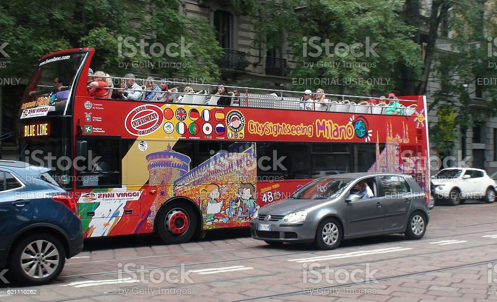Tourists Travelling With Milan City Sightseeing Double Decker Bus stock photo