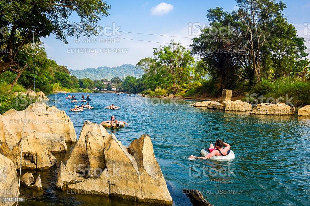 Tourists Tubing Down Song River at Vang Vieng, Laos stock photo