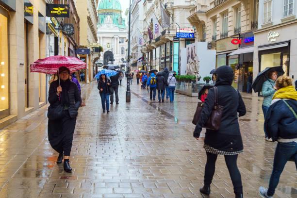 Tourists under colorful umbrellas on a rainy day, Vienna, Austria stock photo