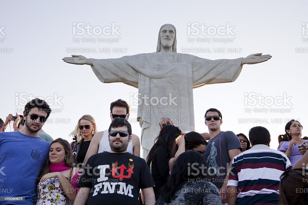 Tourists under statue of Christ the Redeemer in Rio, Brazil royalty-free stock photo