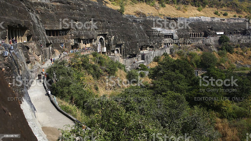 Tourists visit cave carvings at the Ajanta Caves stock photo