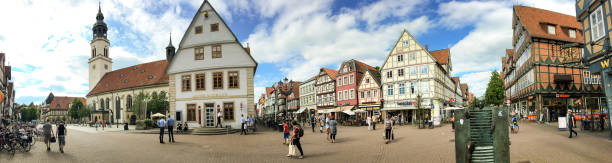 CELLE, GERMANY - JULY 2016: Tourists visit city center. Celle attracts 3 million people annually CELLE, GERMANY - JULY 2016: Tourists visit city center. Celle attracts 3 million people annually. annually stock pictures, royalty-free photos & images