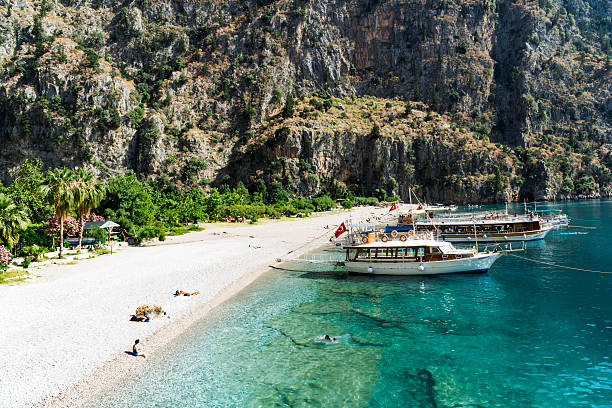 Tourists visit famous Butterfly Valley beach near Oludeniz in Turkey ストックフォト