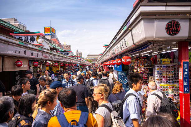 Tourists visit Nakamise Shopping Street leading up to Sensoji Temple in Asakusa, Tokyo, Japan stock photo